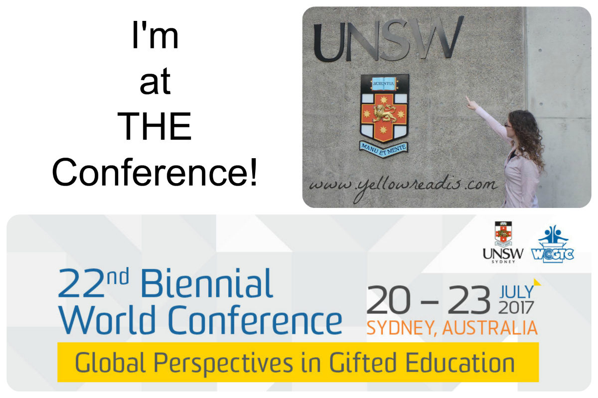 Image of woman pointing to UNSW University sign and banner