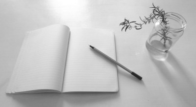 Image: Blank book and pen and vase with rosemary
