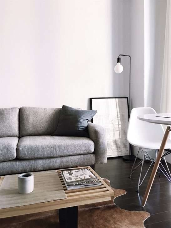 a typical lounge room with sofa, table and lamp