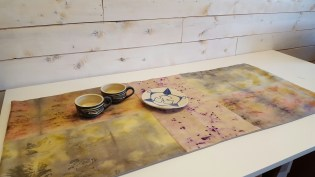 Naturally dyed and pieced table runner featuring pottery by Erin Callahan St. John