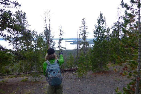 Heather points out the Lake Hotel from a viewpoint.