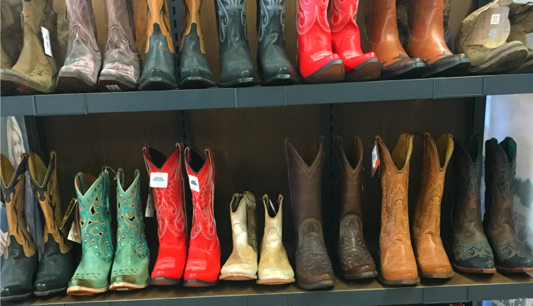 cowboy boots on shelf