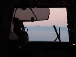 As we flew into Santiago, we could see, through the cockpit window, Mount Aconcagua sticking out above the cloud line of the Andes at sunset
