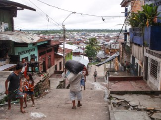 The poorer end of town, where the market is, extends out to life on stilts above the water