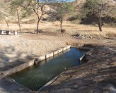 Tucked in a little valley, not so far from the main road after all, the promised hot mud pool