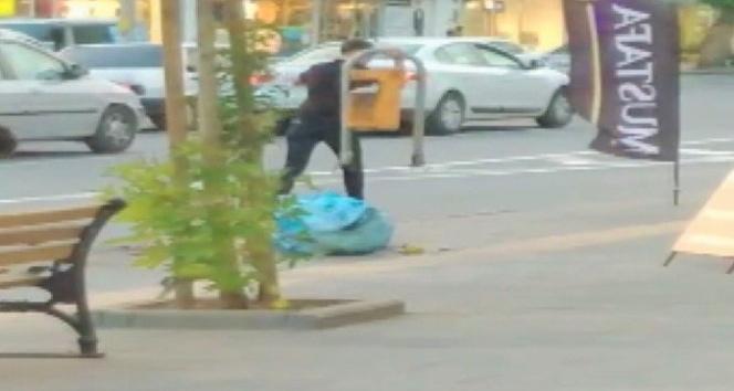 Kaldırımdaki çöp kutusunu söküp götüren genç yakalandı