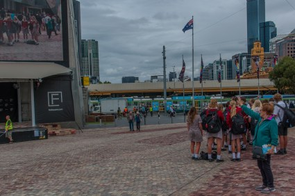 Mum spots herself on the large screen in Federation Square.