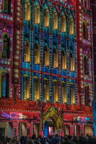 One of the buildings lit up by a projection.