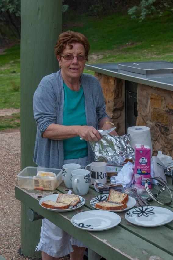 Mum making breakfast at the BBQ area.