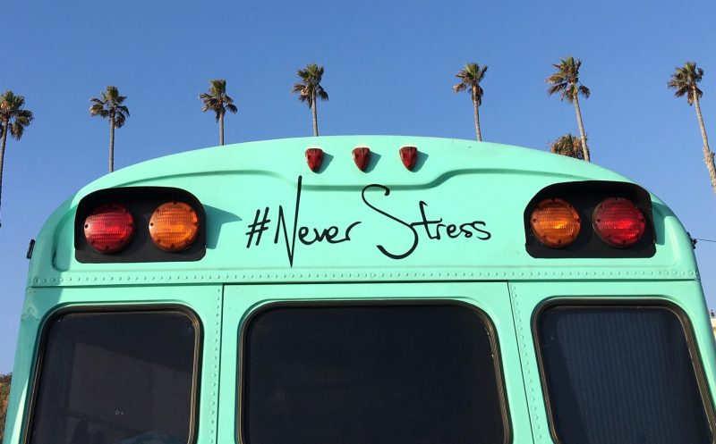 School bus in California with #NeverStress written on the back