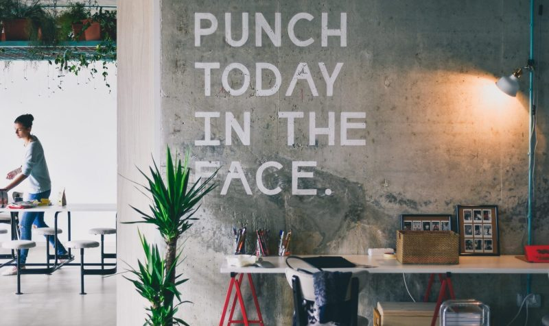 Is Blue Monday Marketing dead? Article by Tom Harvey on the YesMore Beverage Marketing Agency Blog. Image of a concrete wall with the words 'PUNCH TODAY IN THE FACE'