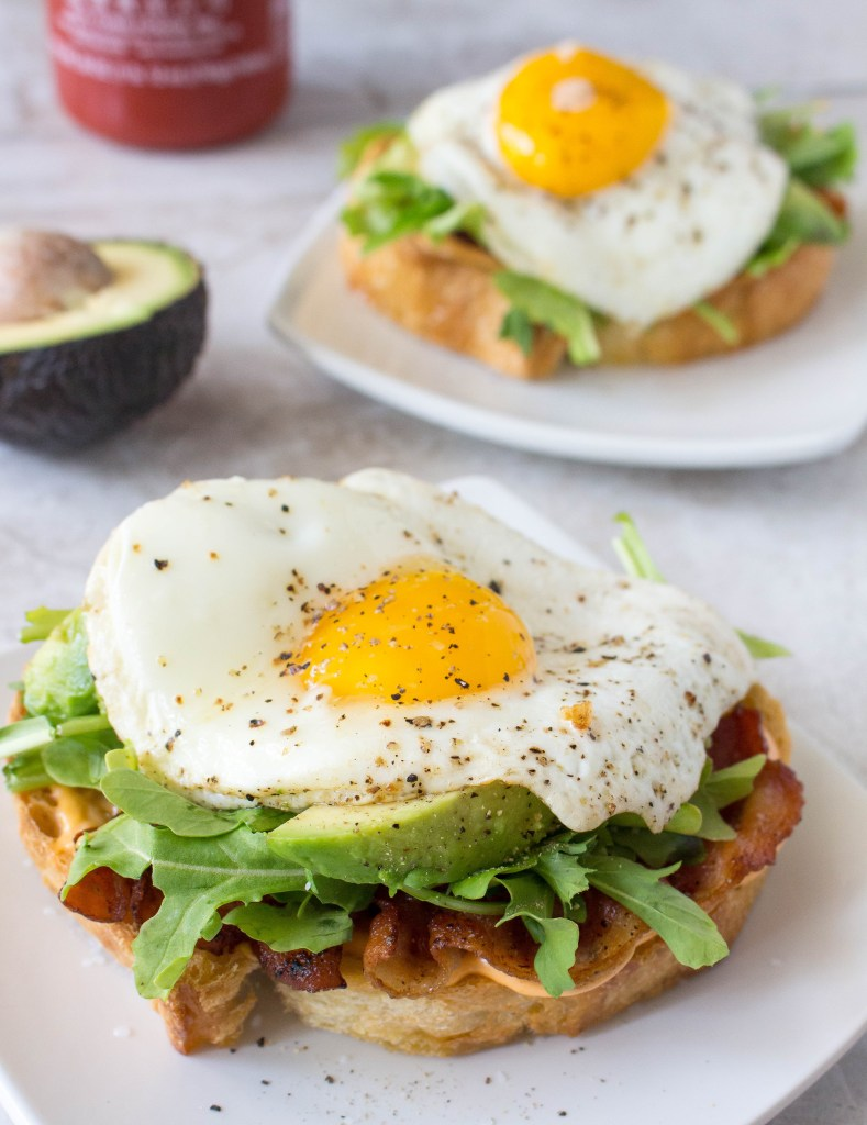Open-Face Egg Sandwiches with Bacon, Avocado, & Sriracha Aioli