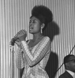 ABBEY LINCOLN,SINGER THEN(HAS AFRICAN NAME NOW).SHE IS MY FIRST BLACK IS BEAUTIFUL HAIR STYLE MENTOR AND TAUGHT ME HOW TO GO A NATURAL ETHIOPIAN UPSWEEP NATURAL)