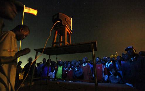 WATCHING THE INAUGURATION CEREMONY AT KIBERA,NAIROBI KENYA,JAN.20,2009