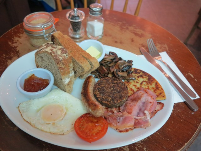 Scottish Breakfast, including haggis, sausage, egg, and toast