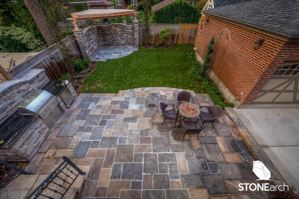 wood deck vs stone patio which is the