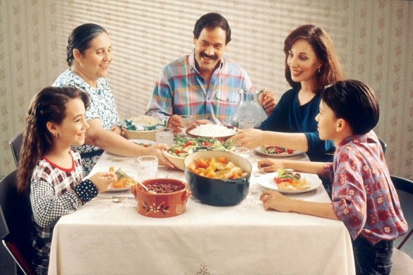 Spreading happiness depicted by a photo of a family together at dinner table