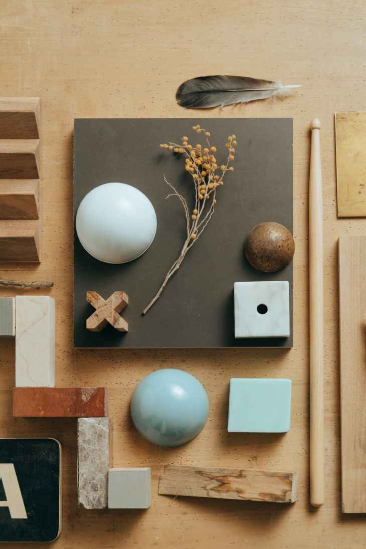 blue egg on brown wooden chopping board