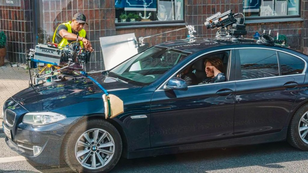 Tenet BTS: IMAX camera rigged to the hood of BMW. Source: IMDB. Credit: Unknown