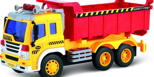 Toy dump truck for kids that makes realistic sounds and has working headlights that are battery powered