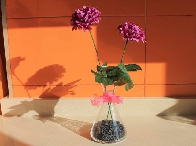 aceitera con flores