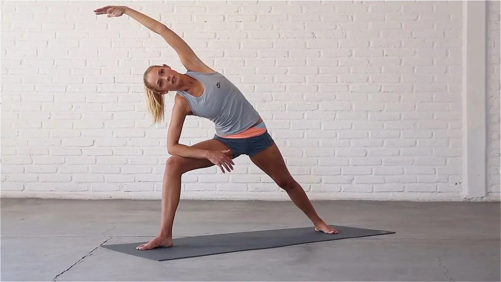 Extended Side Angle opens up the hips and stretches the obliques.