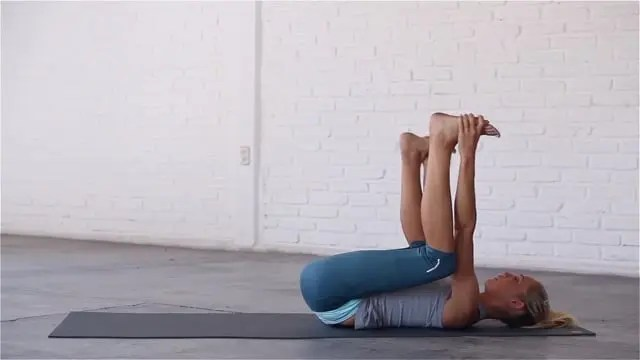 Happy Baby is a restorative pose that opens up the hips.