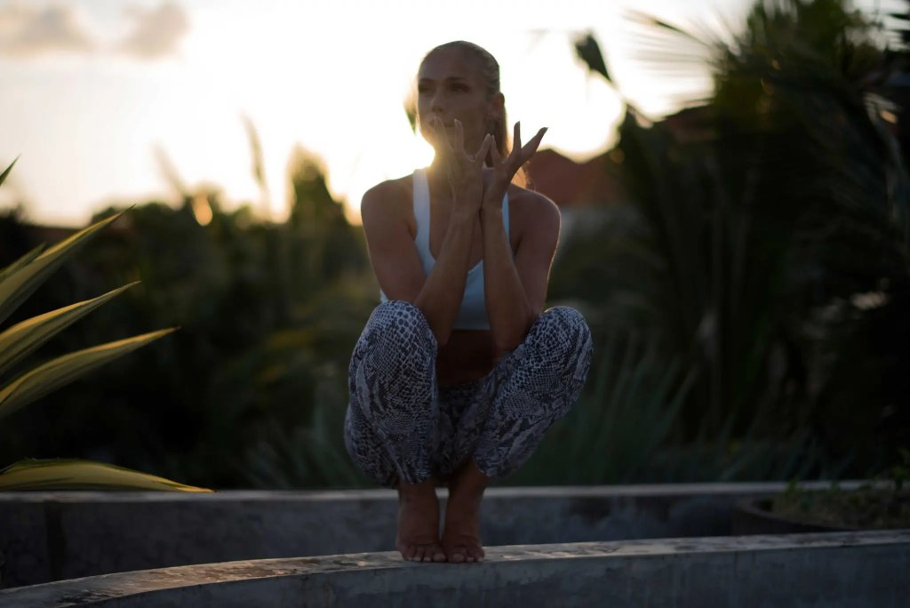 Lotus Squat pose for practicing balance.
