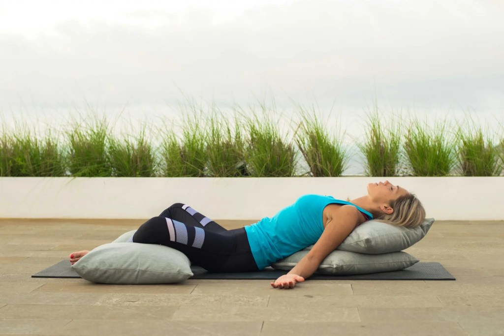 Reclining Butterfly stretches the groin and releases tight hamstrings.