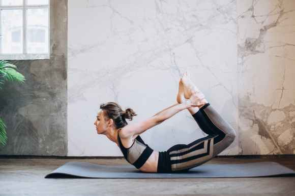 woman bow pose
