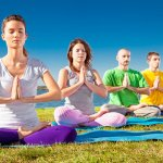 Group of young people have meditation on yoga class. Yoga concep
