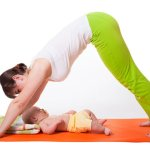 Young Woman Mother Practicing Yoga With Baby