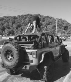 enjoying downward facing dog on my jeep