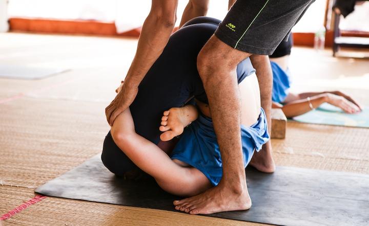 500 Hour Yoga Teacher Training Teacher Adjusting