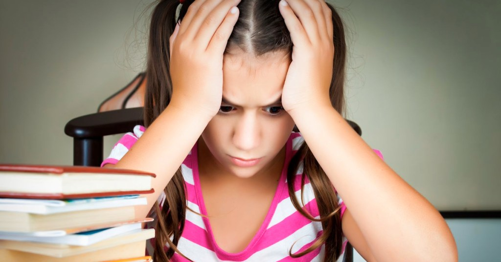 Frustrated Child with School Books