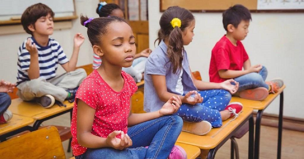 Students Meditating on Desks