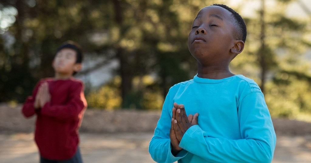 Children Meditating in Park