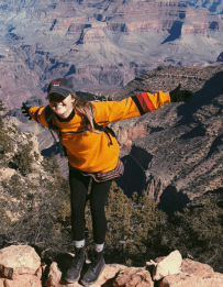 Lauren Gold - balancing with back to the grand canyon