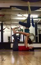 Supported shoulder stand at AcroYoga class