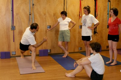 Bruce Roger teaching Parivrtta Parsvakonasana. Photo: Sara Swaty Roger, 2006