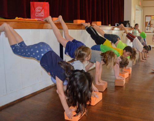 Kids. Yoga hangstands