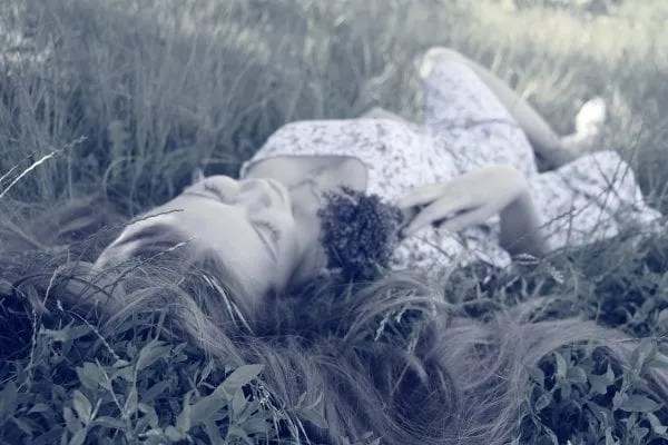 woman laying in the grass