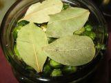 Add vinegar and bay leaves