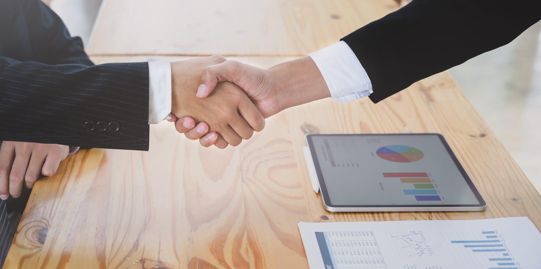 photo of people doing hand shake