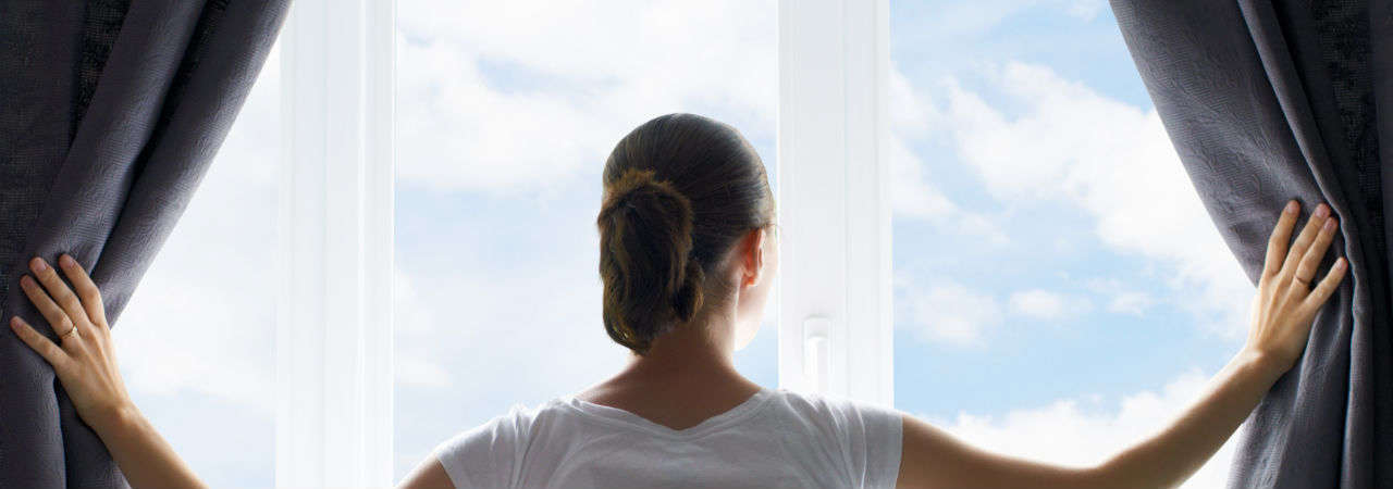 Image of woman looking out the window