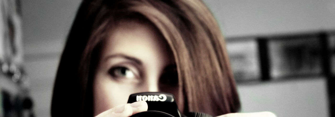 Image of woman using Digital SLR camera