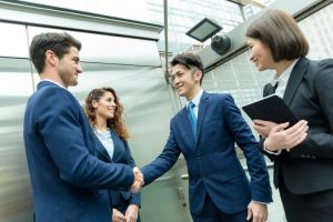 Business people hand shaking at outdoor