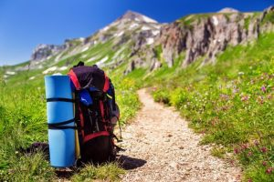 Tourist backpack with a rug near hiking trail in the mountains of the Caucasus, Adygea