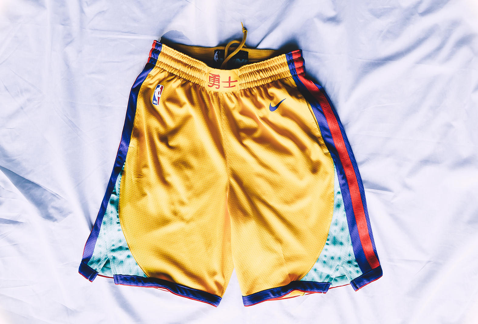 c7bbc44e69c2 The shorts are also gold and feature the Chinese characters representing  prosperity along the waistband. Other notable details include Nike Swoosh  and NBA ...