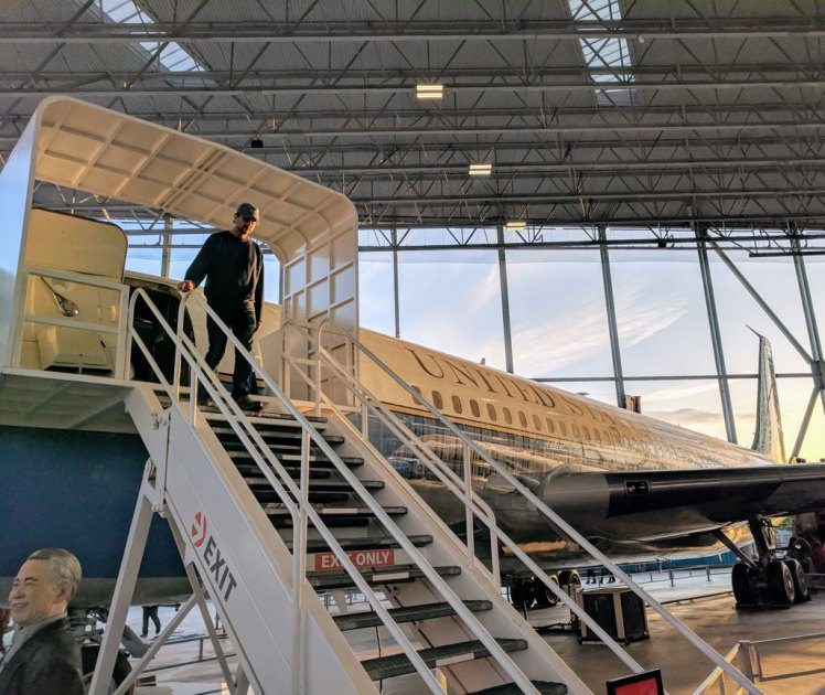 A museum visitor exits an Air Force One plane used by four U.S. presidents